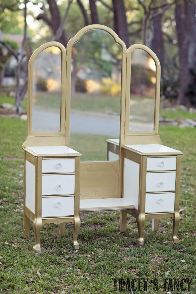 A Regal White and Gold Bedroom Set