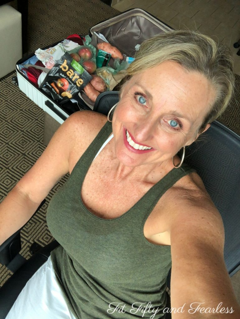 AIP airplane travel | Tracey Bellion | FitFiftyandFealess.com