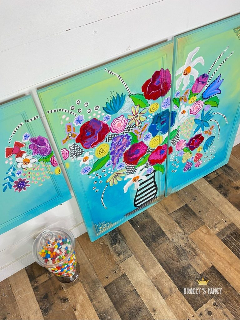 Whimsical boho floral kitchen cabinets hand painted by Traceys Fancy