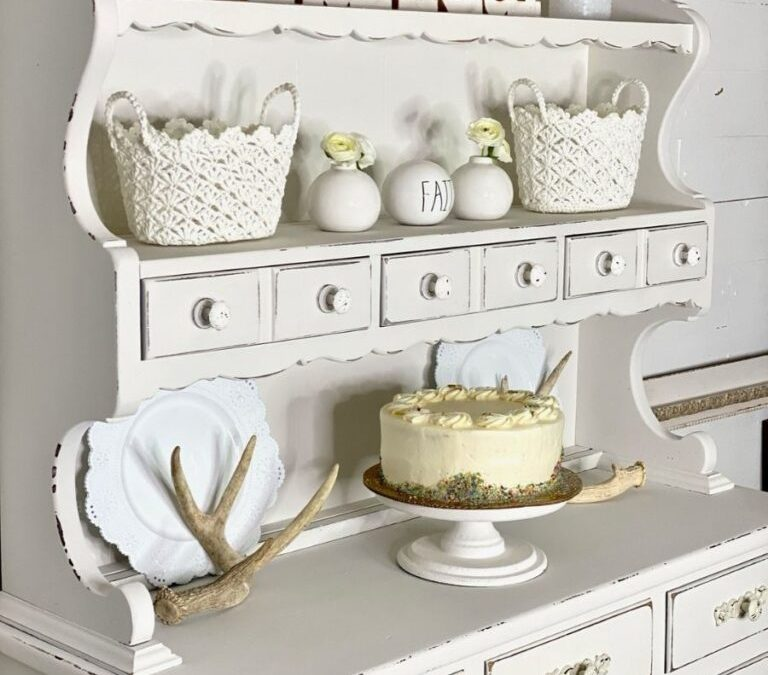 Shabby white china cabinet with a classic farmhouse look